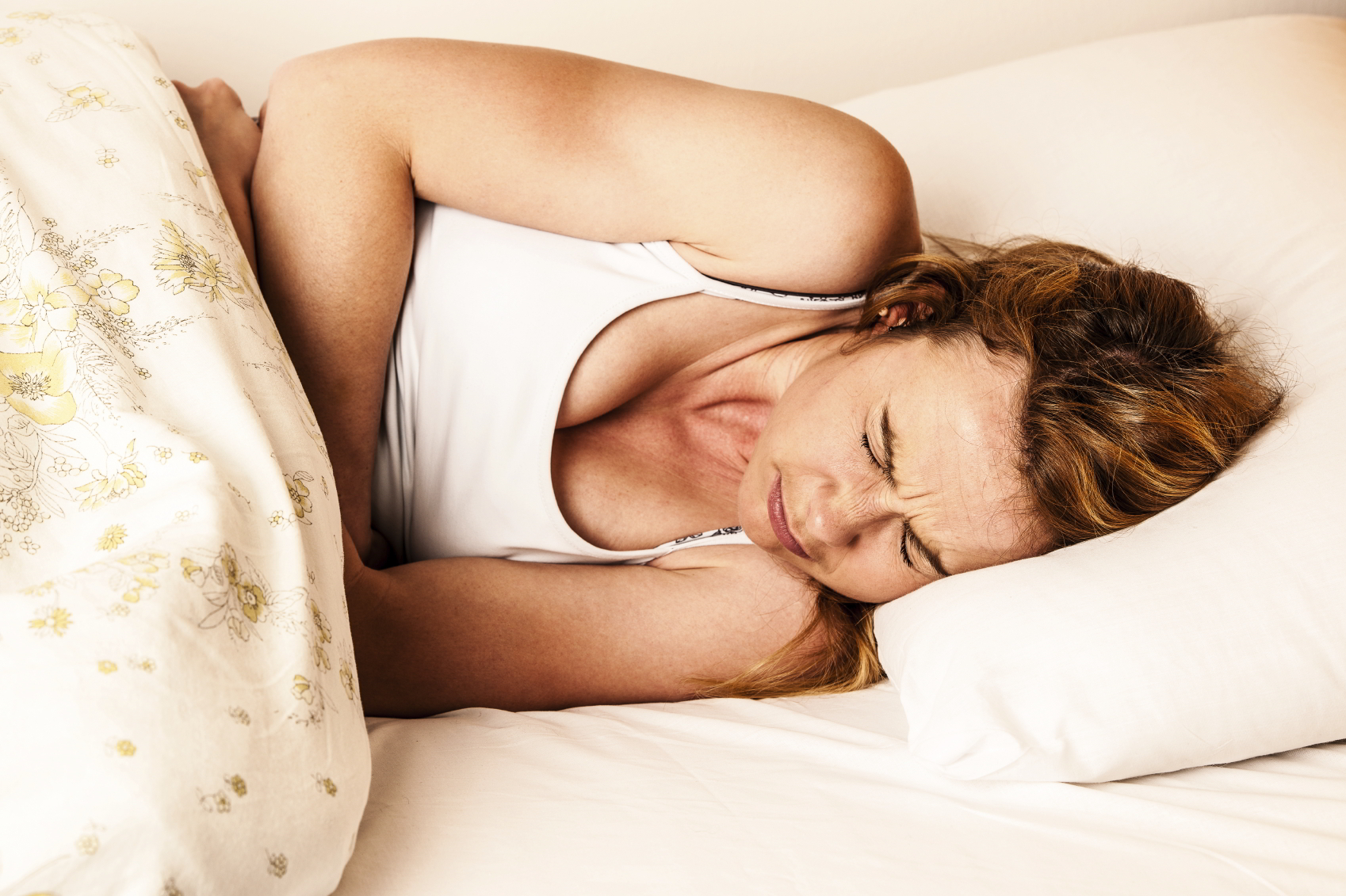 How To Get Rid Of Period Pains In Bed